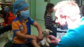 """Three-year-old Austin Bolton from Plymstock having """"Puppy"""" patched up in the children's dept"""