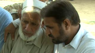 Bereaved Sartaj being comforted