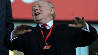 Lord Kinnock celebrating at a football match