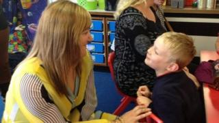Head of School at Bishop Bronescombe C of E School in St Austell, Katie Dalton, with one of the younger pupils