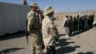 File photo: Australian soldiers, part of the International Security Assistance Force (Isaf), stand near local Afghans at a ceremony to open a Trade Training School at the Tarin Kot military base in Uruzgan province, south of Kabul, Afghanistan, 17 February 2007