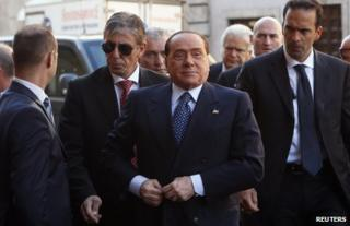 Silvio Berlusconi (foreground) arrives at the Senate in Rome, 2 October