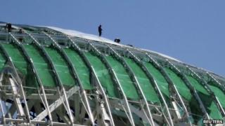 Workers take part in the construction of the Fisht Olympic Stadium for the 2014 Winter Olympic Games in Sochi on 20 August 2013.