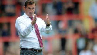 Justin Edinburgh on the sidelines with Newport County.