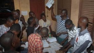 Election workers count ballots in Conakry, Guinea, on 28 September 2013