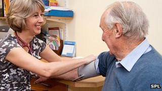 Man getting blood pressure taken by his GP