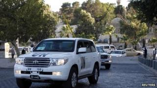 UN vehicles transporting a team of experts from the Organisation for the Prohibition of Chemical Weapons are pictured as they return to their hotel in Damascus, 3 October, 2013.