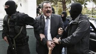 Extreme-right Golden Dawn party senior lawmaker Christos Pappas is escorted by anti-terrorism police officers to a courthouse in Athens 3 October, 2013.