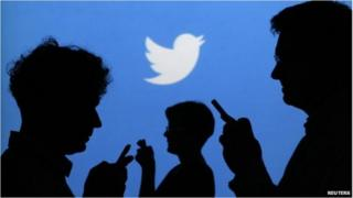 Silhouettes of people tweeting