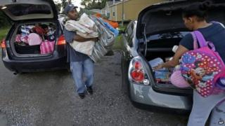 A couple prepare to leave ahead of the storm in Belair, Louisiana, on 4 October.