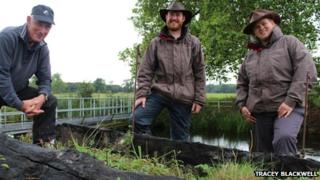 Ted Rice, Hugh Warwick and Katherine Alker from Croome's garden team at the site of the lost Chinese Bridge