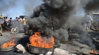 Supporters of united Andhra Pradesh set burning barricades during a protest against the formation of Telangana state, in Kurnool district some 200 kms from Hyderabad on October 5, 2013.