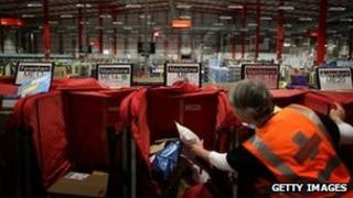 A postal worker in a sorting office