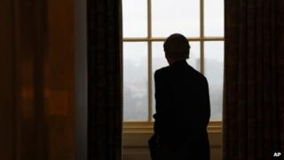 Senate Minority Leader Mitch McConnell looked out of a Capitol window as he returned to his office on 7 October 2013