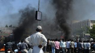 Supporters of united Andhra Pradesh set burning barricades in Kurnool district on October 5, 2013