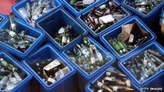 Bottles in recycling bins