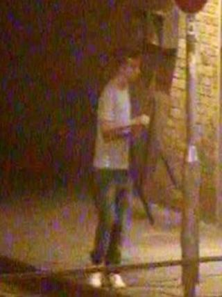 CCTV image of man with chair