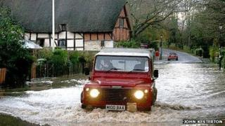 A Land Drover tackling floods near Anne Hathaway's cottage