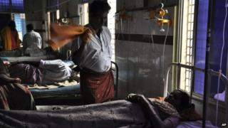 A man fans a patient using a hand towel during a power outage at a government hospital in Andhra Pradesh on Oct 9, 2013