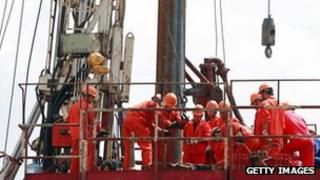 Chinese workers on an oil rig