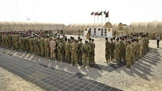 British troops form up on the parade square at Camp 501, Camp Bastion, Helmand Province in Afghanistan
