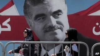 Women pass by a giant portrait of former Lebanese Prime Minister Rafik Hariri near his grave, Beirut, Lebanon. File photo