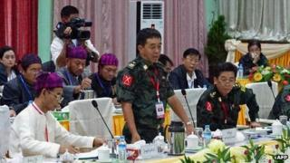 General Gwan Maw (C) of the Kachin Independence Army (KIA) speaks during a meeting between representatives of the Myanmar government and a delegation of the rebel KIO (Kachin Independence Organization) in Myitkyina, in the country's northern Kachin state on 8 October 2013.