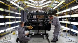 A black cab being produced