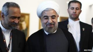 Iran's President Rohani smiles as he walks after speaking in a High-Level Meeting on Nuclear Disarmament during the 68th United Nations General Assembly at U.N. headquarters in New York