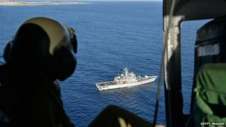 Italian Air Force helicopter looks down on navy ship. 9 Oct 2013