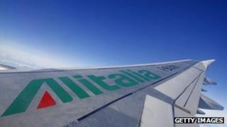 A picture of an Alitalia airplane wing