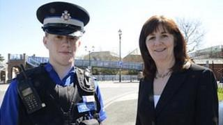 Community support officer Lee Whittaker from Llandrindod Wells with minister Lesley Griffiths