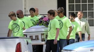 Pallbearers wearing anti-bullying t-shirts carried the casket of Rebecca Sedwick in Florida on 16 September 2013
