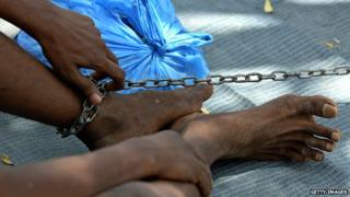 Patient in Somalia mental hospital with chain on leg