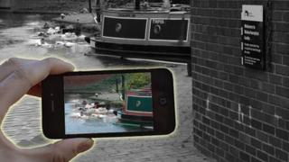 Smartphone taking a picture of a canal barge