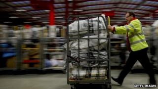 A Royal Mail worker in sorting office