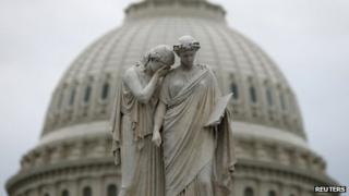 The statue of Grief and History stands in front of the US Capitol Dome in Washington on 16 October 2013