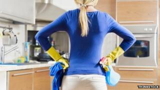 Woman contemplating housework