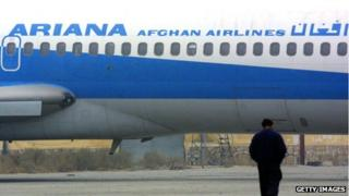 An Afghan man walks towards an Ariana Afghan Airlines plane on the tarmac at the Kabul airport January 10, 2002 in Kabul, Afghanistan.