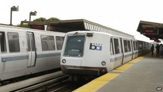 Bay Area Rapid Transit trains wait to board passengers at the Fruitvale station in Oakland, California on 12 October 2013