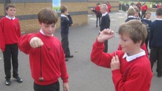 Children playing conkers