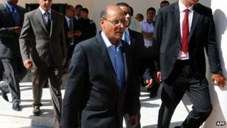 President Moncef Marzouki leaves the memorial ceremony. 18 Oct 2013