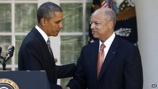 Jeh Johnson (right) and President Barack Obama (left) appear at the White House on 18 October 2013