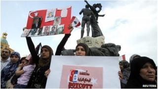 Relatives of the nine Lebanese held as hostages by rebels in the northern Syria town of Azaz hold placards during a sit-in to demand their release