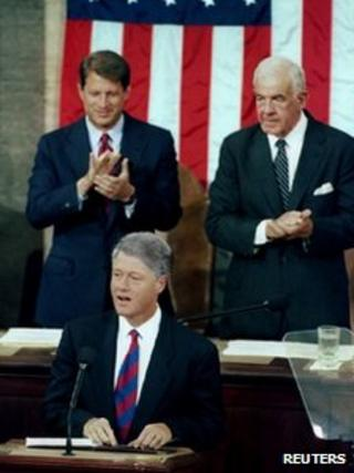 US President Clinton is applauded by Vice President Al Gore and House Speaker Tom Foley (r) as he addresses a joint session of Congress on 22 September 1993