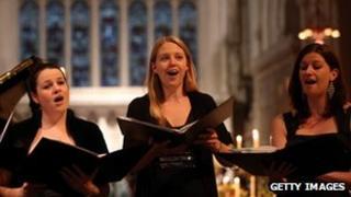 singers in a choir reciting hymns