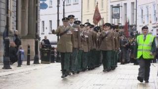 The regimental banner is paraded through Enniskillen