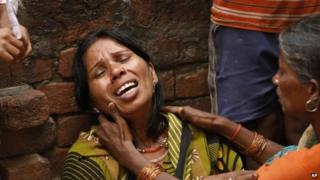 Poonam, whose two relatives died after drinking toxic liquor, wails at Atardiha village in Azamgarh district, on Sunday, Oct 20, 2013