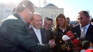 Recep Tayyip Erdogan hands cash to Sultan Akten