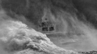 Ferry leaving Newhaven harbour in storm, East Sussex, by David Lyon